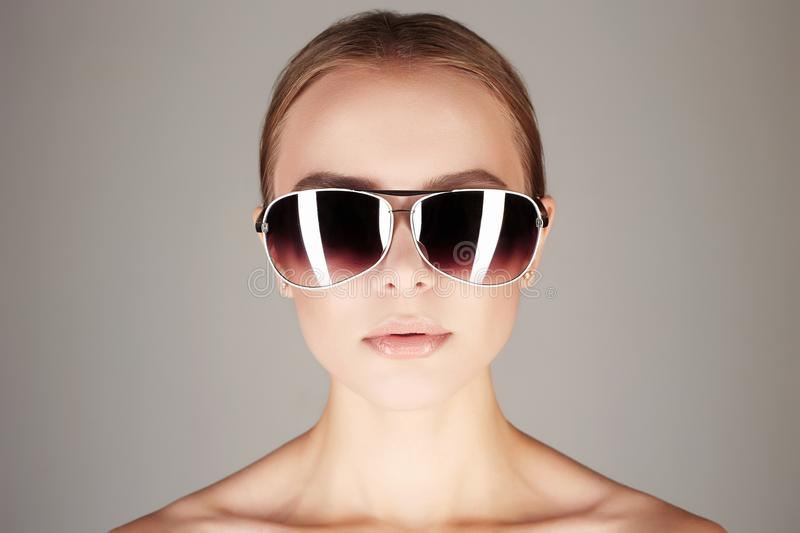 Woman in sunglasses.fashionable girl royalty free stock photos