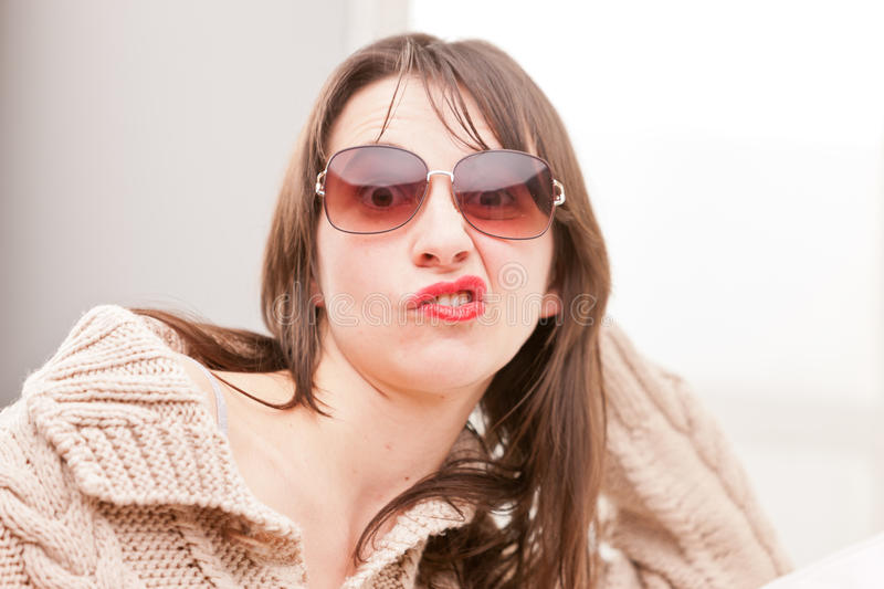 Woman with sunglasses making funny faces stock photos