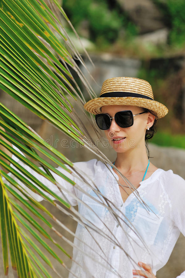 Download Woman In Sunglasses Near Palm Tree Stock Photo - Image: 29219300