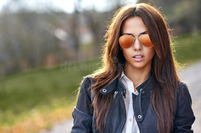 Woman in sunglasses - outdoor fashion portrait stock photo