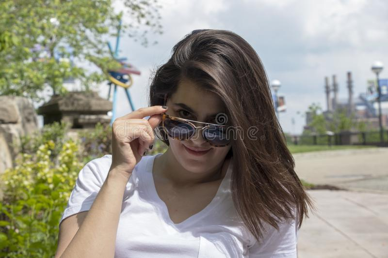 Woman with sunglasses in the park stock photos