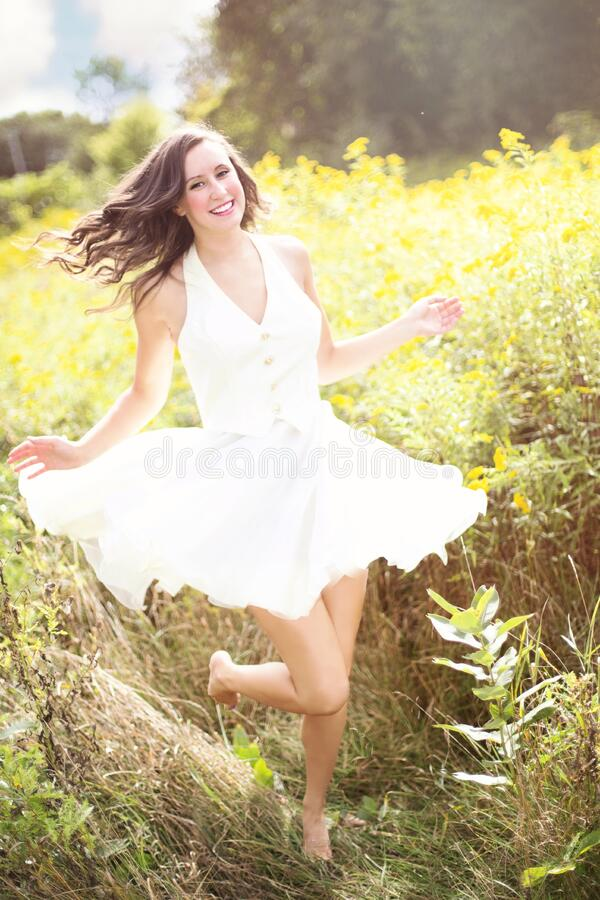 Woman in sunny field royalty free stock images