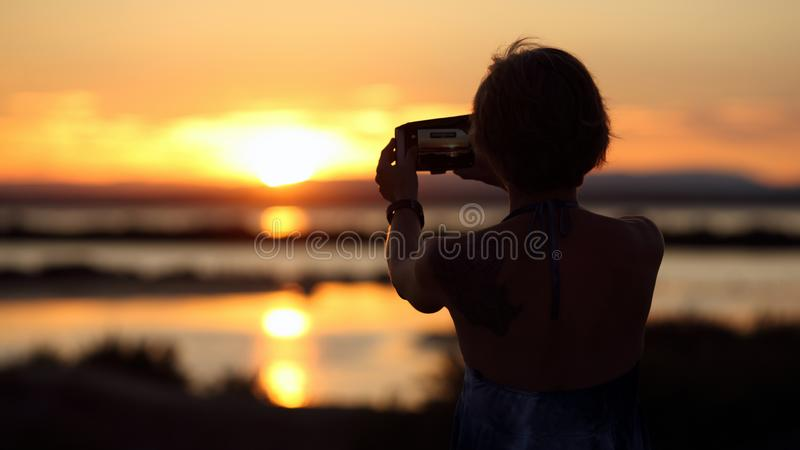 Woman and sunset stock image