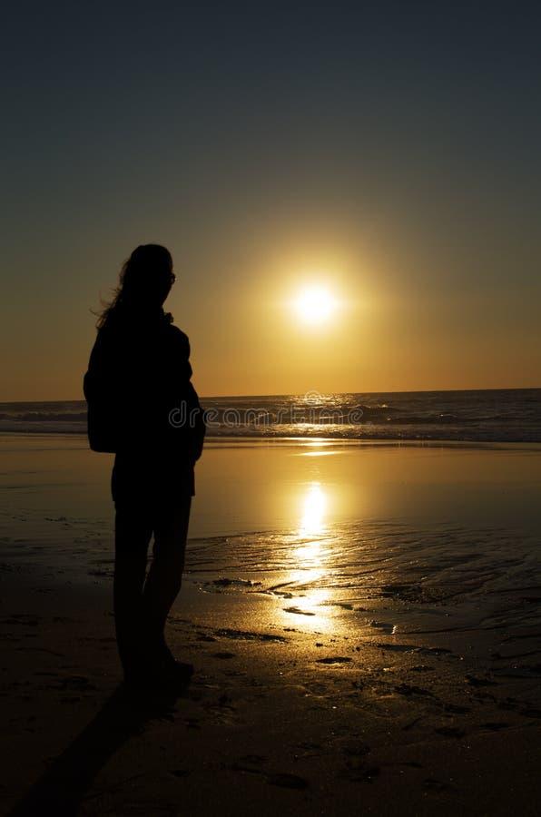 Woman sunset silhouette stock photos