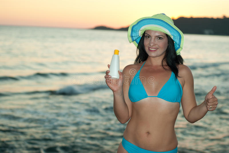 Woman With Suntan Lotion Gives Thumbs Stock Photo
