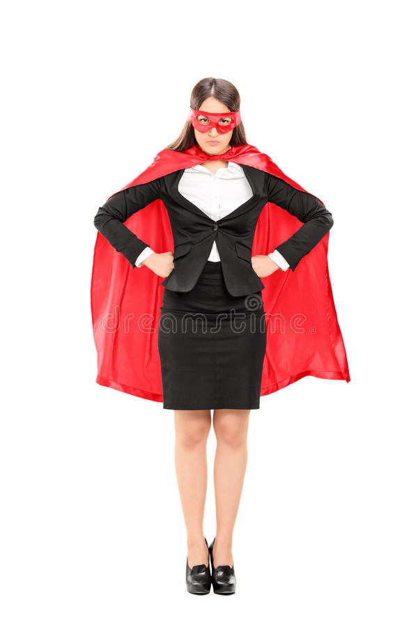 Woman in superhero costume standing proudly stock images