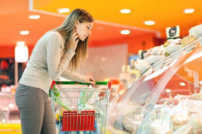 Woman at supermarket royalty free stock photos