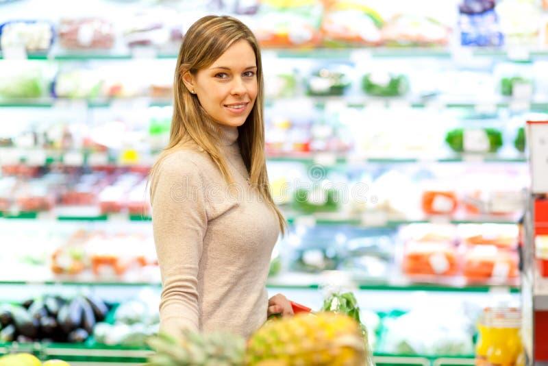 Woman at supermarket royalty free stock photo