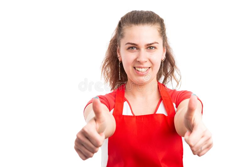 Woman supermarket employee showing thumbs up stock images