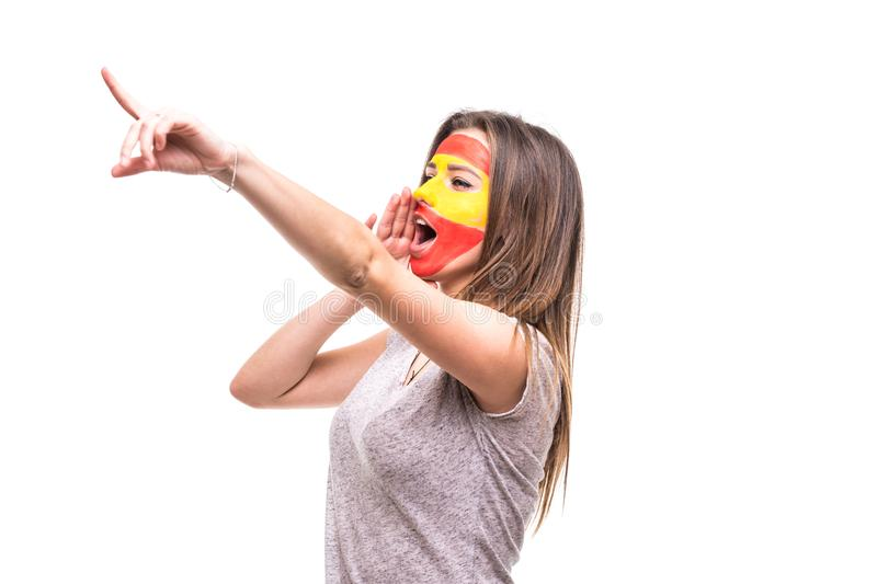 Pretty woman supporter fan of Spain national team painted flag face get happy victory screaming pointed hand. Fans emotions. stock images