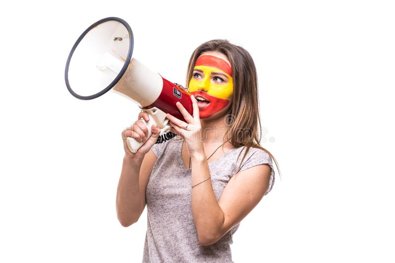 Woman supporter loyal fan of Spain national team painted flag face get happy victory screaming into megaphone with pointed hand. F stock image
