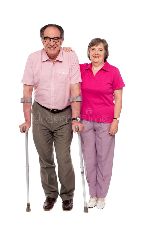 Woman Supporting Her Handicapped Husband Stock Images