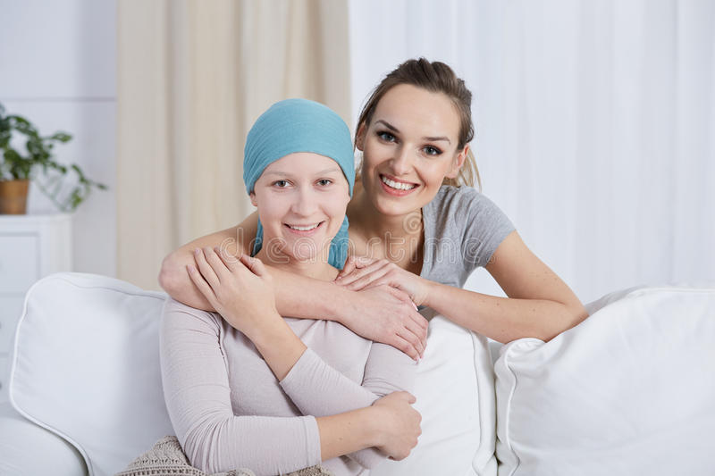 Woman supporting her ill sister stock image