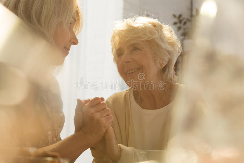 Woman supporting her old mother royalty free stock photography