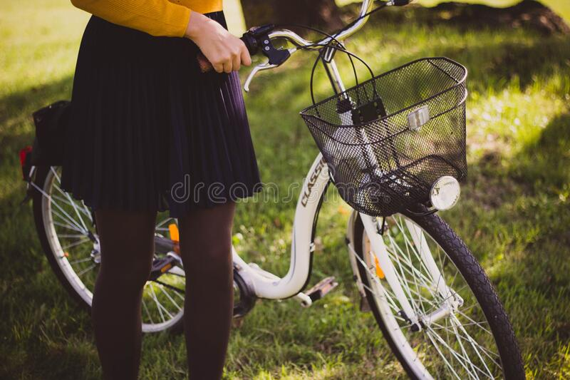 Woman supporting a new white bicycle royalty free stock images