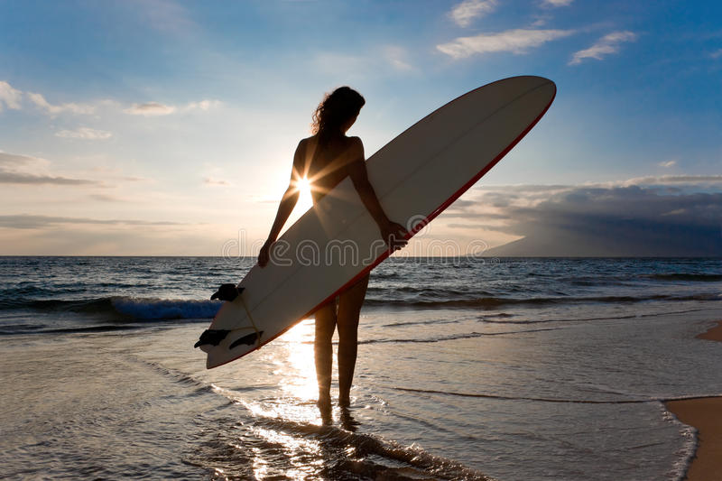 Woman surfboard sun. Woman with surfboard and shinning sun light royalty free stock photography