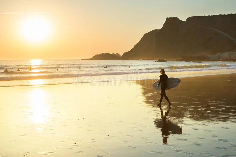 woman surfboard walking beach Portugal stock photography