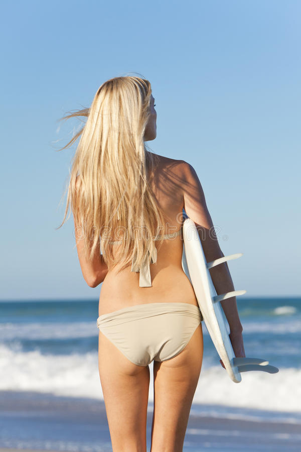 Woman Surfer In Bikini With Surfboard At Beach royalty free stock photography