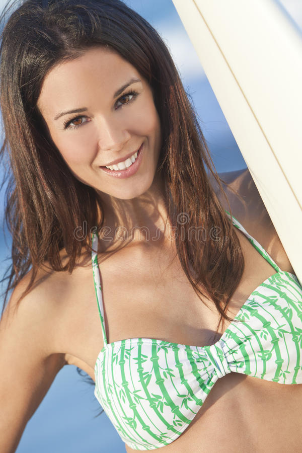 Woman Surfer in Bikini With Surfboard at Beach stock photos