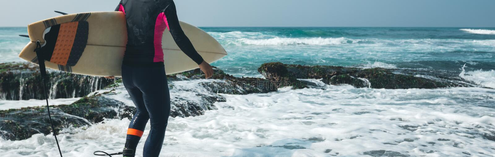 Woman surfer with surfboard royalty free stock images