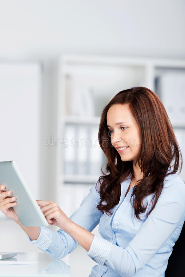 Woman surfing on her tablet computer stock photos