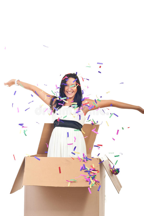 Woman surprise. Beautiful woman out of the box at party with confetti falling down stock photography