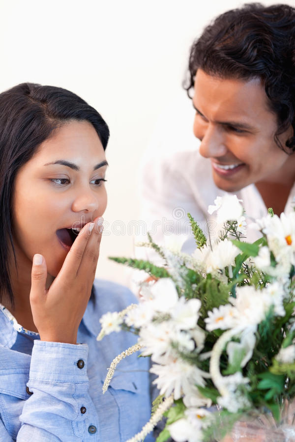 Woman Surprised By The Bouquet Stock Photo