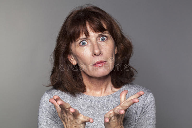 Woman surprised with hand out stock photography