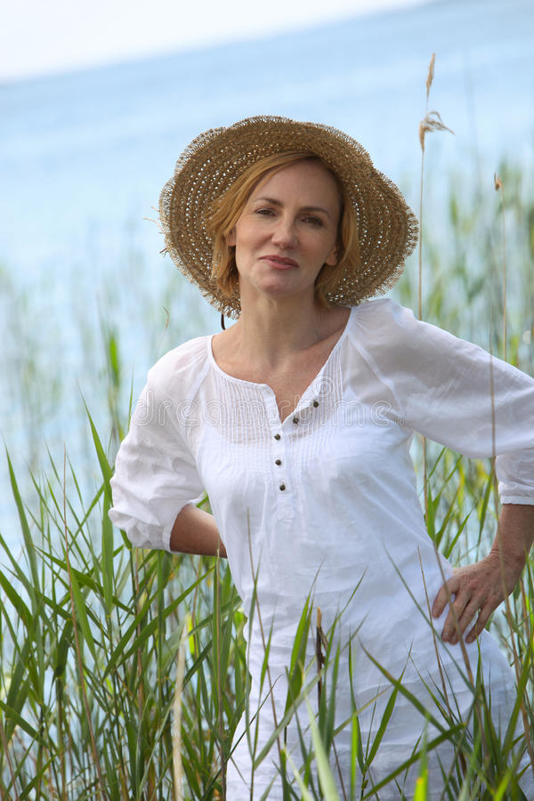 Download Woman surrounded by reeds stock image. Image of person - 30013973