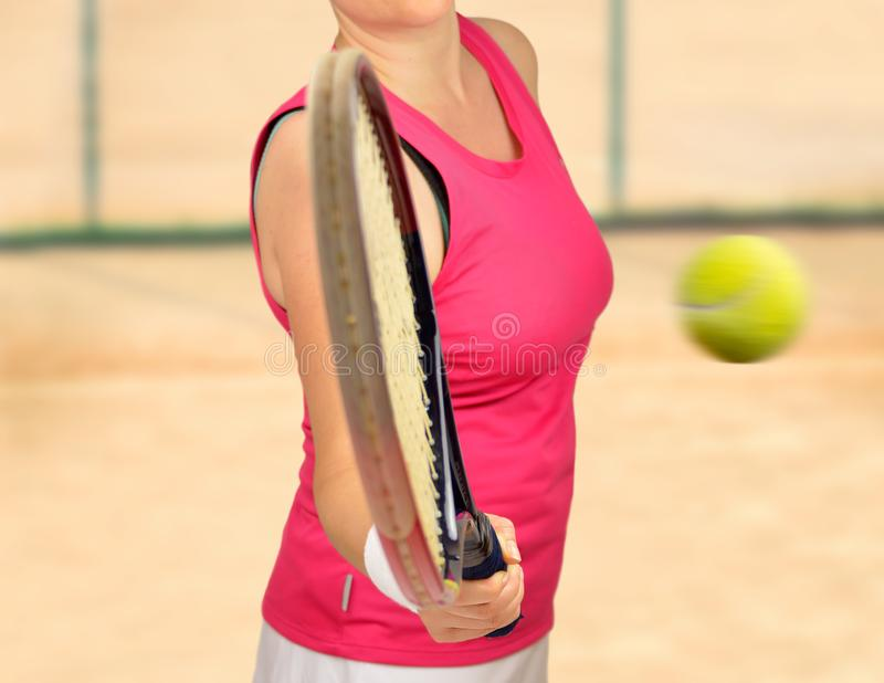 Woman swatting the tennis ball royalty free stock photography