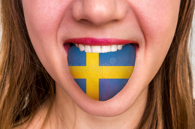 Woman with swedish flag on the tongue royalty free stock images