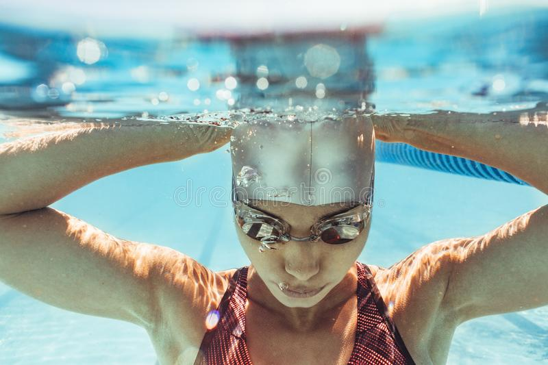 Woman swimmer inside swimming pool stock photo