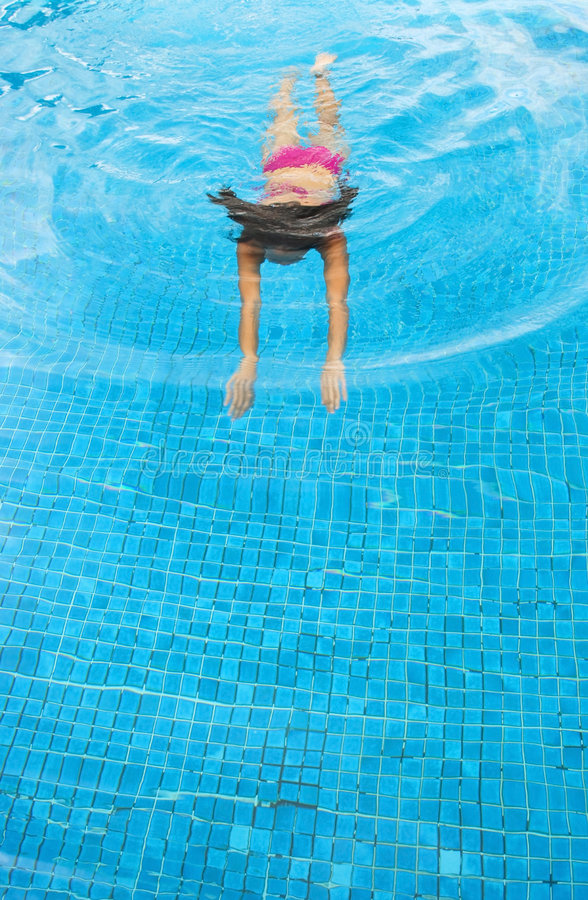 Woman swimming stock images