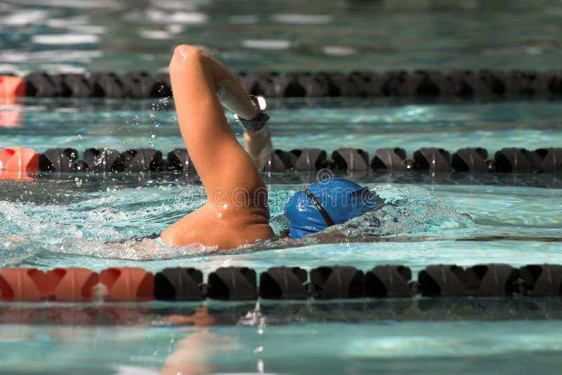 Woman swimming freestyle stock photos