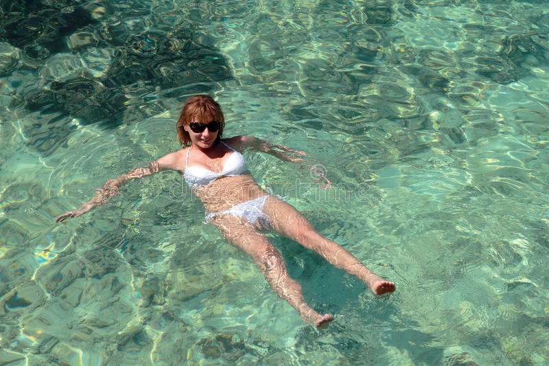Woman swimming in the Maldives royalty free stock image
