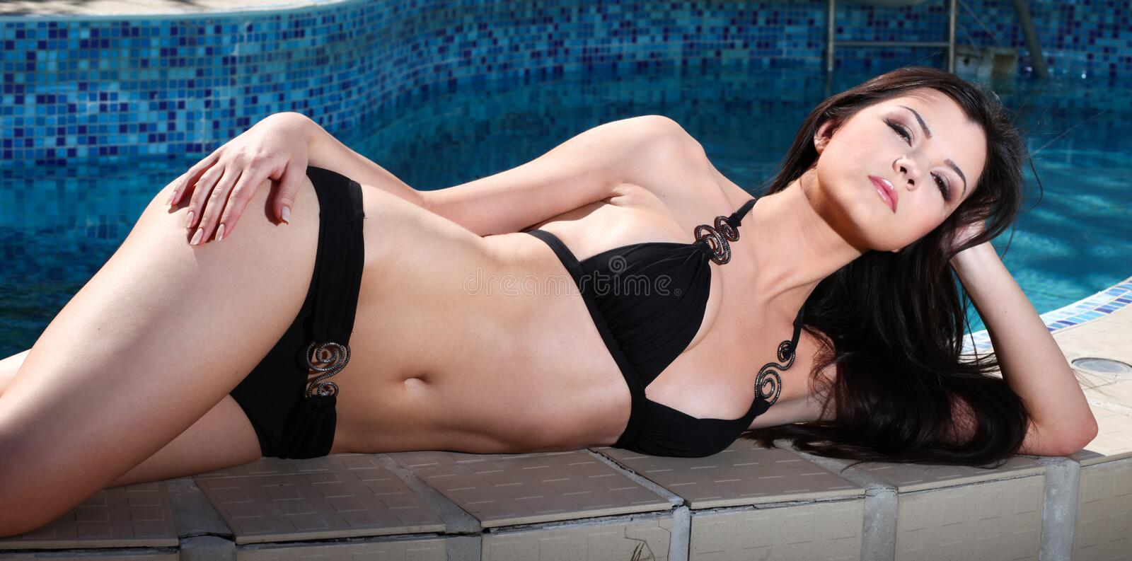 Download Woman And Swimming Pool Royalty Free Stock Photography - Image: 22619967