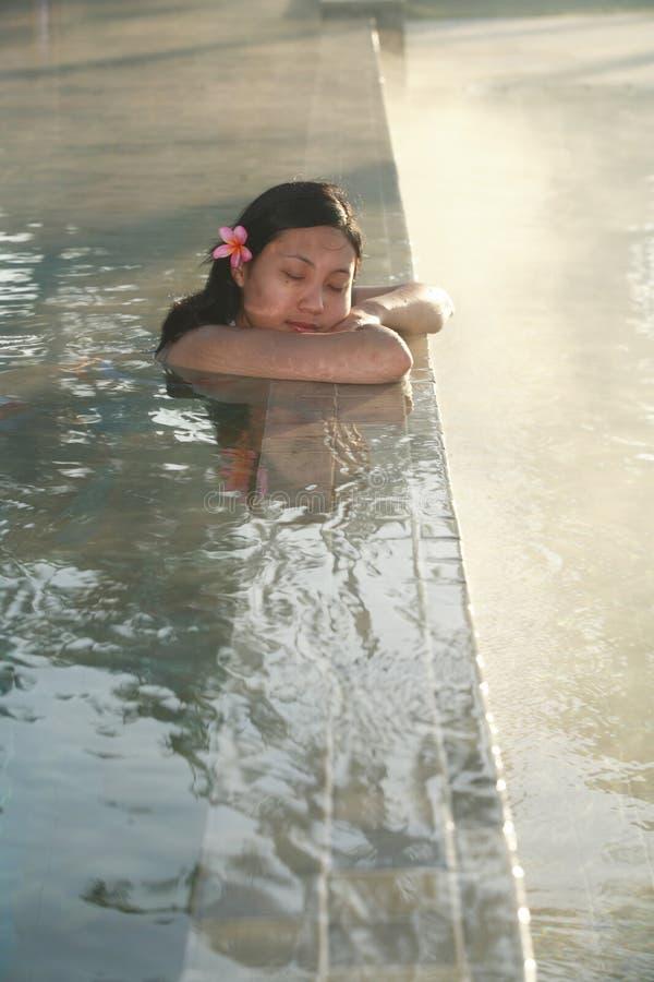 Woman swimming pool royalty free stock photo