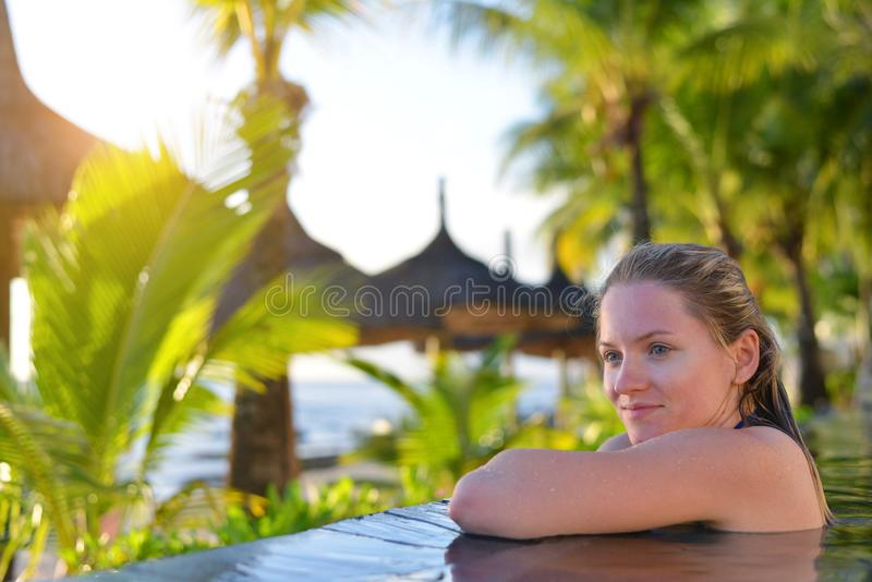 Woman in swimming pool. At tropical island Mauritius royalty free stock photo