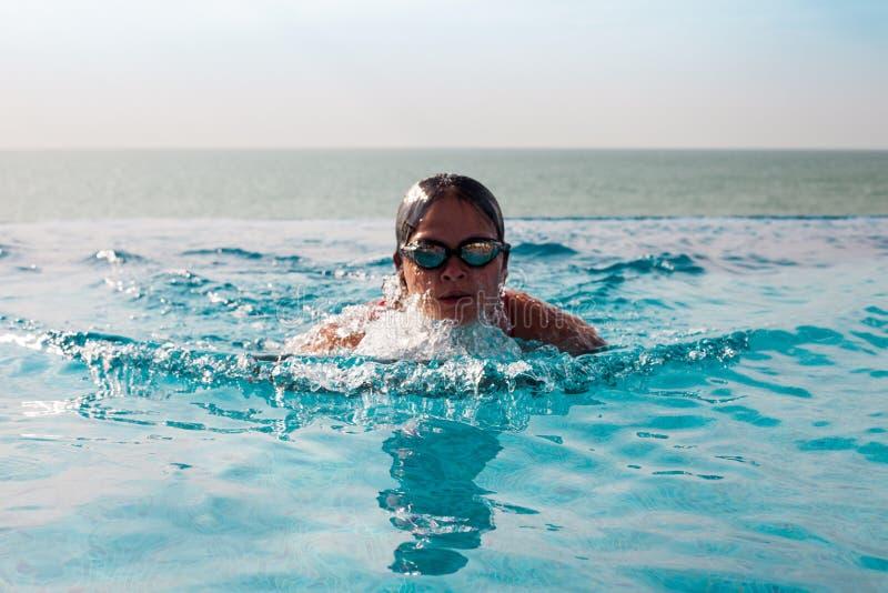 Woman swimming in a pool stock photo