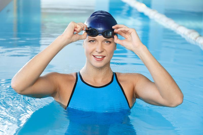 Woman in swimming pool royalty free stock images
