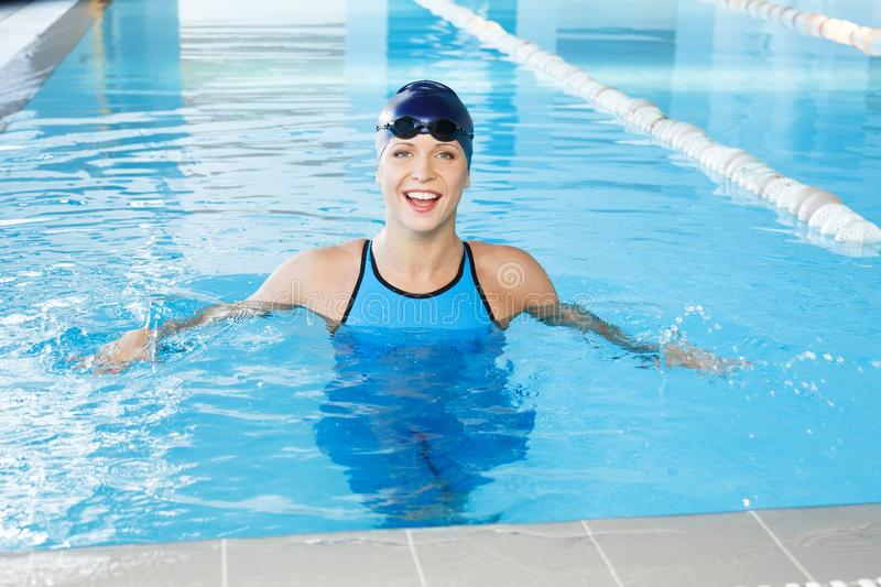 Woman in swimming suit near pool royalty free stock image