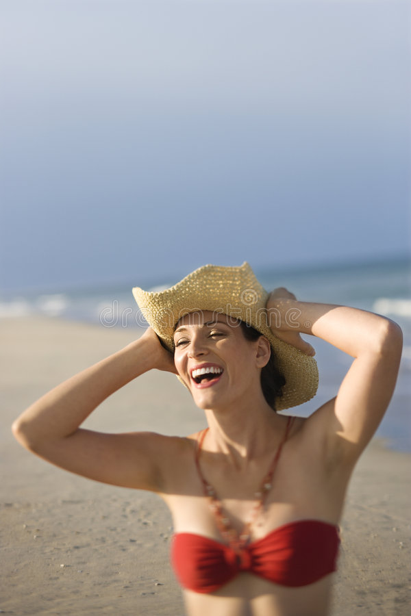 Woman in swimsuit at beach. stock image