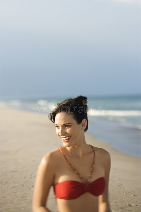 Woman in swimsuit at beach. royalty free stock photo