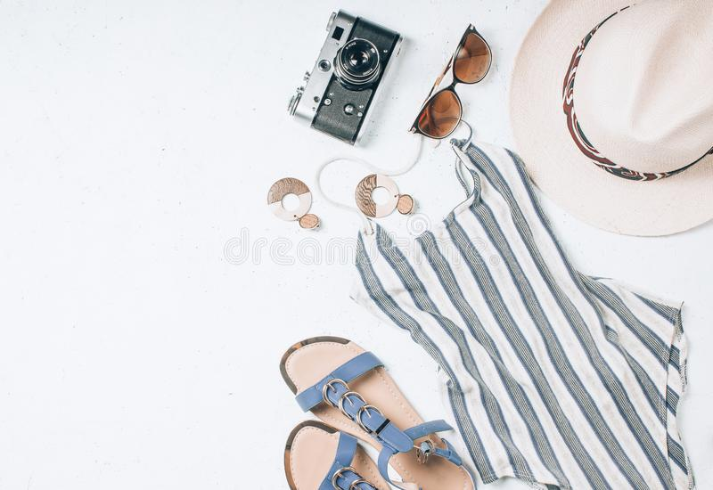 Woman swimsuit beach accessories collage on white background. Women`s summer clothes background. Woman swimsuit beach accessories collage on white background stock photos