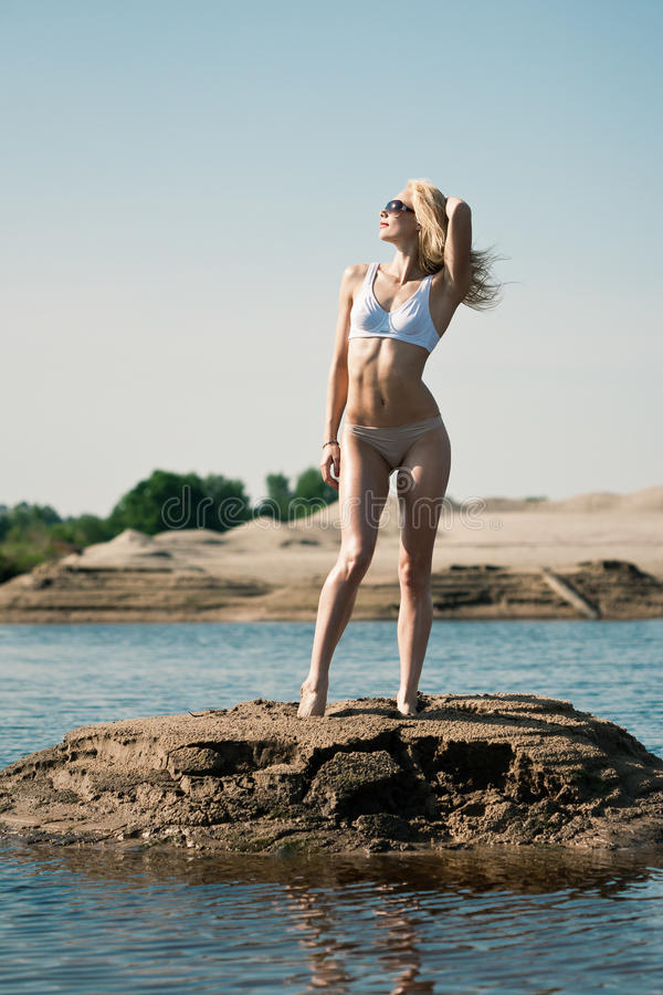 Woman In Swimsuit On Hill Royalty Free Stock Photo