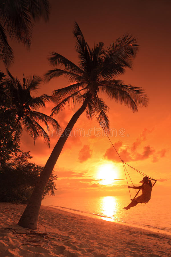 Woman Swinging On A Sunset Stock Photography
