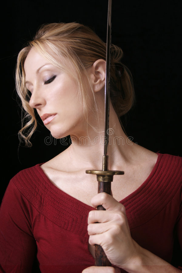 Woman with sword. Female holding a samurai sword stock images