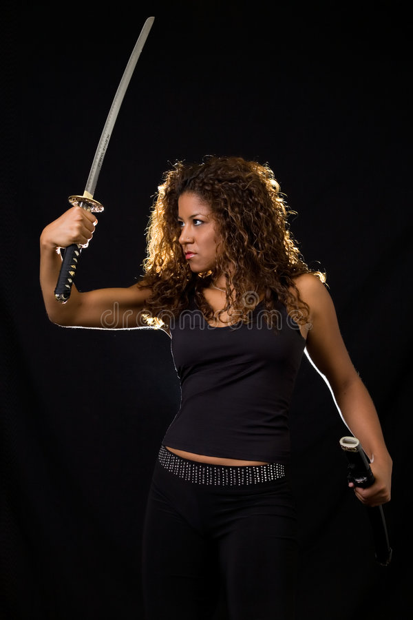 Woman with a sword royalty free stock photo