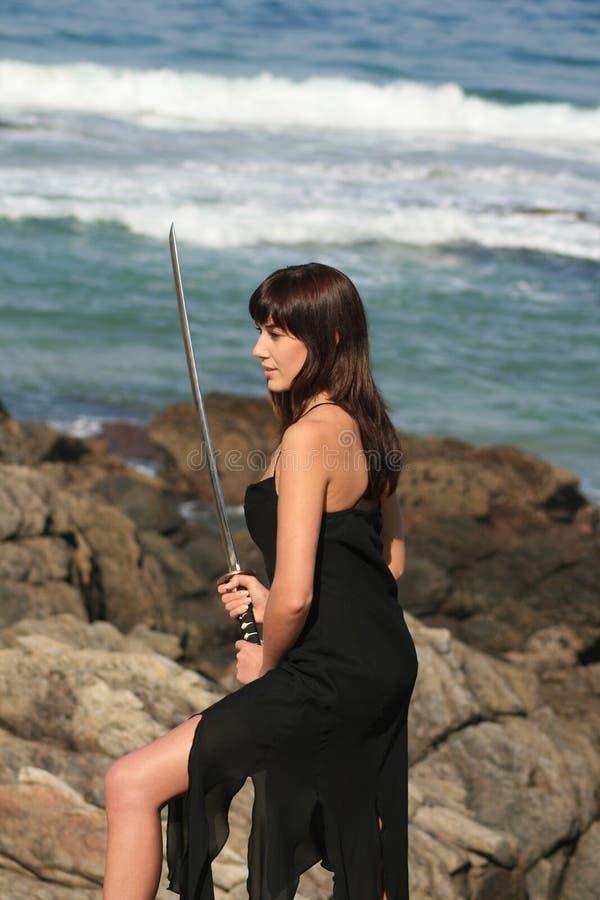 Woman with sword stock photos