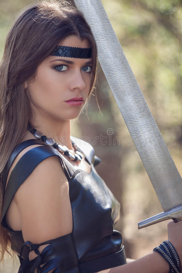 Woman with sword, cosplay stock image